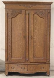 Fancy carved oak wardrobe