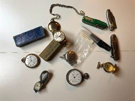 Antique pocket watches and knives.