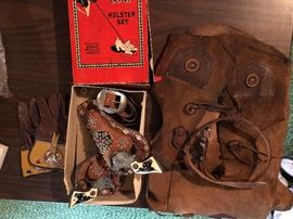 Antique cap gun set, kids gloves, vest and belt