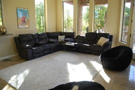 Sectional Sofa with electric recliners.  Dark gray with off white top stitching.  Area Rug.  Swivel Barrel Chairs