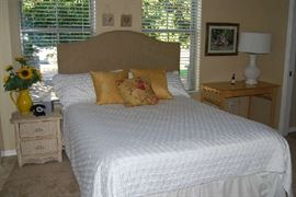 Queen Bed with studded headboard.  Side Table, Linens, Décor.  White table lamp is not part of sale.