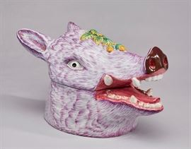 French Faience Majolica Boar's Head Tureen.           Mid 20th century French Faience Majolica pottery boar's head tureen. The lavender or purple hand painted face of the boar has an embossed acorn and oakleaf decoration on the top. Hand painted mark on underside, France. Measures 9.7 inches high x 15.6 inches long. In good condition.