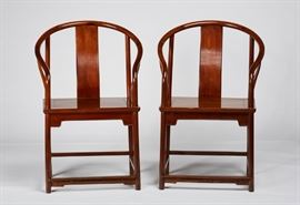 Pair Carved Chinese Huanghuali Horseshoe Armchairs Pair of 19th century or older Chinese Huanghuali horseshoe armchairs. Chairs have a simple molded carved apron. Good condition, one has all four legs ended out and the other has back legs ended out. Measure 40.2 inches high x 23.2 inches wide x 17.6 inches deep.