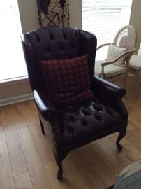 Maroon leather wingback chair