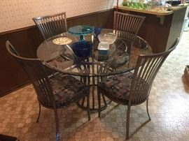 Great Beveled round glass top table and 4 iron chairs