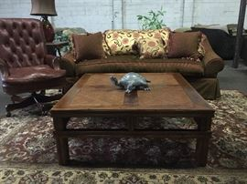 Chinese four paneled Coffee table with Palecek furniture label,  button back office chair by Hickory  chair and Rene Cazres sofa with iridescent upholstery.