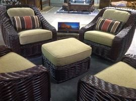 Woven swivel arm chairs with ottoman