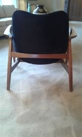 Back view of Mid-Century black velvet upholstered chair which sits so beautifully inside its teak wood frame.
