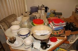 Dishes, place mats, hot pad holders, Table and chairs
