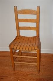 One of Two Straight  Back Wood Chairs