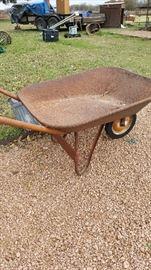 Old rusty wheel barrow