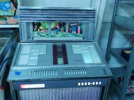 rock ola juke box with 45s powers up and all may need couple adjustments