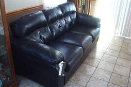 Black leather blend sofa.