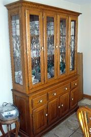 Oak china cabinet with leaded glass doors.