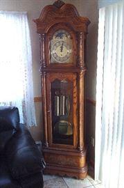 Howard Miller grandfather clock in good running order.