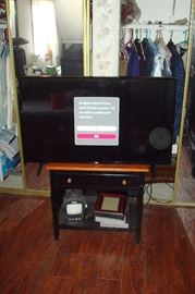New LG 43 inch HDTV and maple and black painted nite stand.