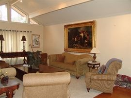 Living room opposite view with oil painting and furniture