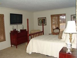Guest bedroom with solid cherry Davis Cabinet Company  chests and poster bed and night stand