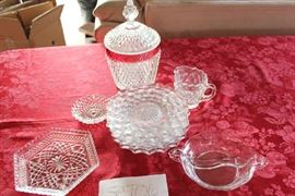Lot #6 Collectable Glass Dishes.  Lot Includes: Six 8 inch Fostoria American Pattern plates Fostoria divided serving or candy bowl 6 inches Small Hexagon Serving bowl 7 inches Fostoria American pattern cream server 4 inch small candy dish 6 in x 10 in candy dish red & crystal