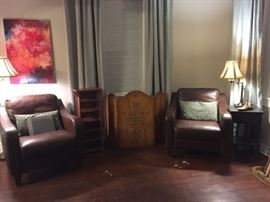 Brown Leather Club Chairs, Small Shelf, Stenciled Wood Fireplace Screen, Small Black Table, Floor Lamp, Table Lamp.