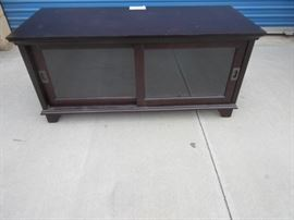 Low buffet / cabinet with sliding front doors