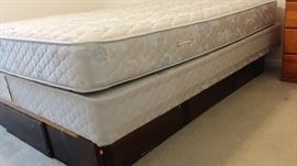 Queen wood bed frame with underbed drawer storage.