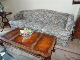 Camel Back couch; Vintage coffee table