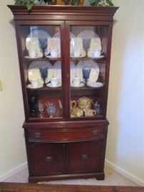 Vintage mahogany china cabinet, and all its contents.
