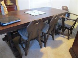 Antique Irish pub table with chairs and a bench