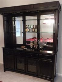 """Solid wood bar cabinet dark Cherry finish: recessed lighting in the canopy with brass holders for glassware, Full mirror back w/ 2 glass shelves, 4 drawers, 2 cabinets & 1 double glass door wine storage rack, glass doors are etched and wine storage has a brass light fixture(71""""W x 18"""" L x 84"""