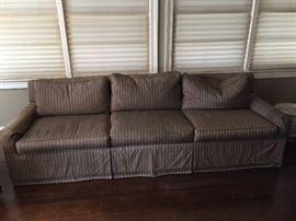 Long, three cushion, down stuffed, upholstered (silk blend) sofa.