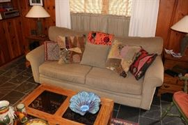 Great Corduroy Sofa, Oak & Glass Coffee Table, Dancing Rabbit Pottery Bowl, Talavera Pottery Pieces, Colorful Toss Pillows