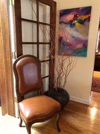 Leather side chair and large ceramic pot