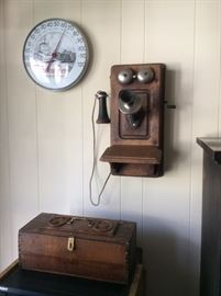 Advertising thermometer, old telephone, carved box