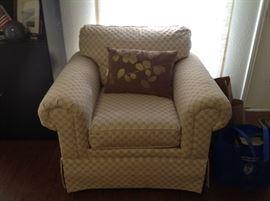 Neutral color armchair.
