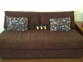 Second sofa has matching chair and ottoman.