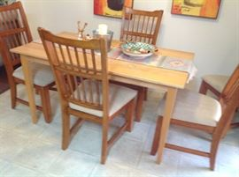 Dining table and five chairs.