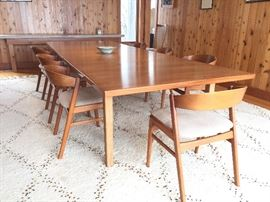 BUY IT NOW! 11 1/2' long dining table (3 leafs) and 7 chairs.