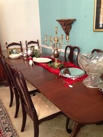 The Queen Anne dining table has several leaves.