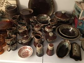 Brown drip pottery (Canonsburg?) Large setting, including platters, serving bowls, salt and pepper, covered putter, pitchers, sugar and creamers, covered dishes, cups saucers, plants, bowls, etc.