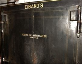 "TAKING OFFERS ON THIS GEM, BEST OFFER SUBMITTED BY SATURDAY EVENING WILL OWN.     PATENTED 1922' GALVESTON ""EIBAND'S"" SAFE ON WHEELS - WE HAVE THE COMBINATION. OPENS AND CLOSES FINE. THIS SAFE WAS PART OF EIBAND'S WOODWORK FOR MANY YEARS."