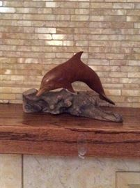 Wood dolphin figurine