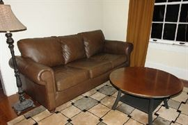 Leather sofa and copper top coffee table