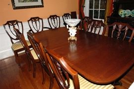 Banded dining room table with fine reproduction shield back chairs by Henkel Harris in excellent condition