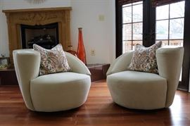 "Vladimir Kagan, ""Nautilus"" Swivel Lounge Chairs Pair- custom ultra suede cream fabric"