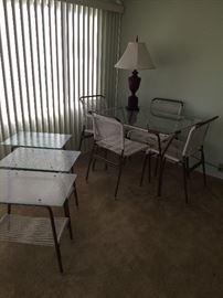 glasstop  table, 4 chairs and 3 side tables.  60's . Perfect condition .