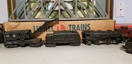 Lionel train with cars , tracks, etc.