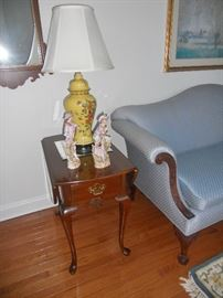 One of a pair of Queen Ann drop leaf end tables