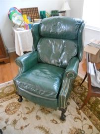 Dark green leather recliner with brass studs by Hancock & Moore
