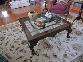 Square, glass top coffee table
